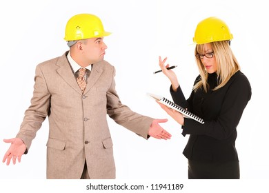 angry businesswoman and architect with architectural plans