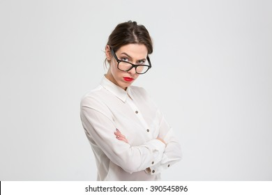 Angry businesswoman in glasses looking at camera isolated on a white background