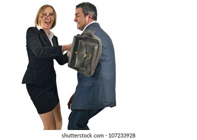 Angry businesswoman is hitting across the businessman