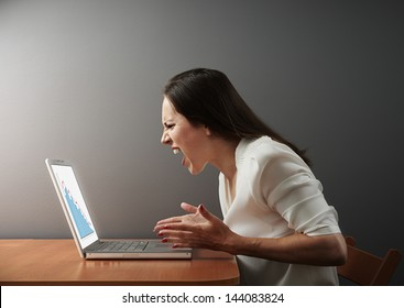 angry businesswoman looking at negative statistic