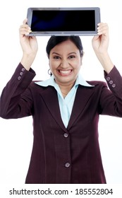Angry businesswoman throwing her tablet computer on white Angry businesswoman throwing her tablet computer on white