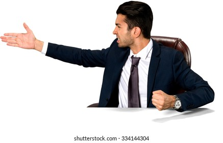Angry Caucasian man with short dark brown hair in business formal outfit pointing using palm - Isolated