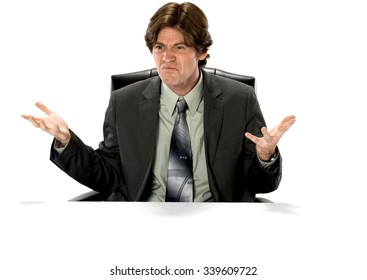 Angry Caucasian man with short dark brown hair in business formal outfit with arms open - Isolated