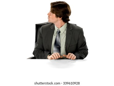 Angry Caucasian man with short dark brown hair in business formal outfit typing on imaginary prop office chair - Isolated