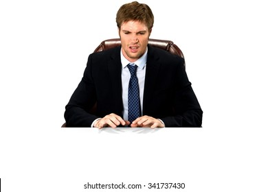 Angry Caucasian man with short medium blond hair in business formal outfit typing on imaginary prop office chair - Isolated