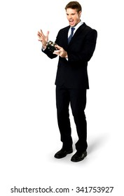Angry Caucasian man with short medium blond hair in business formal outfit holding alarm clock - Isolated