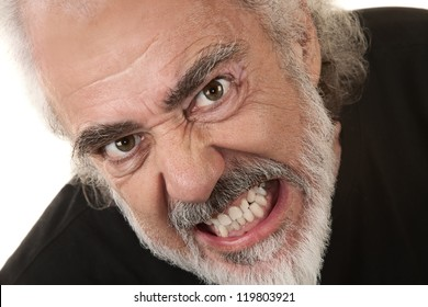 Angry Caucasian senior citizen over isolated background clenching teeth
