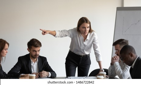 Angry caucasian white female boss manager shout firing sad stressed african american male worker intern at team office meeting, racial discrimination at work, harassment racism at workplace concept