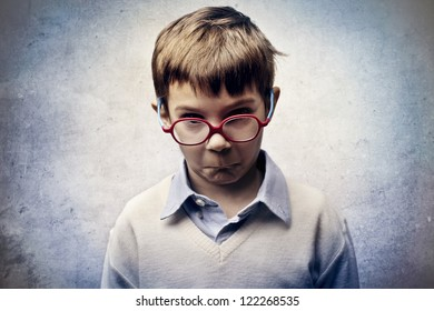 Angry child with red glasses