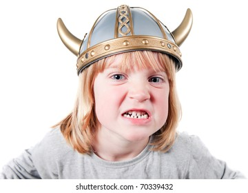 Angry child with viking helmet. boy isolated on white with expression of aggression. blond kid dressed up