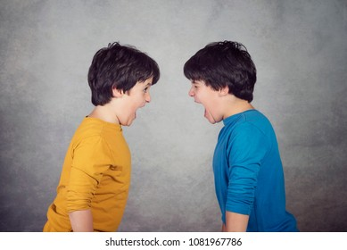 Angry children shouting over gray background