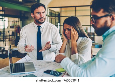 Angry coach disappointed with work of team talking about problems with financial report, male and female members of working group quarreling during collaboration fail with software updating on laptop