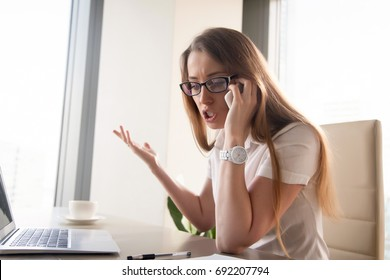 Angry confident businesswoman arguing while talking on phone, annoyed woman having conflict during telephone conversation in office, dissatisfied entrepreneur shouting when negotiating by mobile