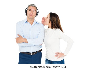 Angry couple arguing and ignoring each other on white background