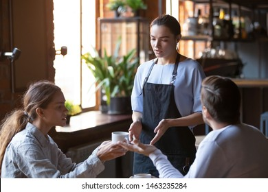 Angry couple client talk dispute with millennial waitress feel dissatisfied with cafe bad service, mad disappointed customers speak with staff complain about wrong order, blame in incompetence