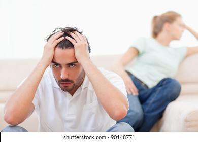 Angry couple mad at each other in their living room