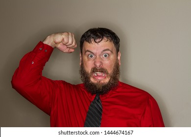 angry coworker raising his fist in anger