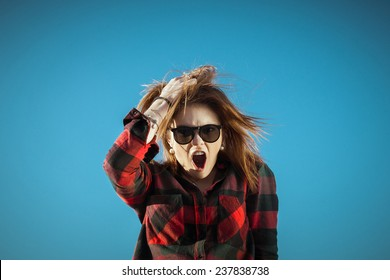 Angry crazy hipster girl grabs hair