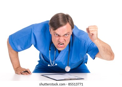 angry doctor in blue posing at table