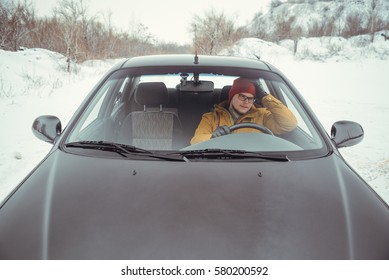angry driver in car talking by phone