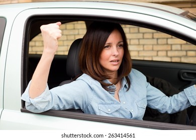 angry driver waving fist