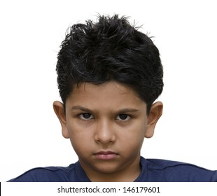 Angry eight year old indian boy from south asia