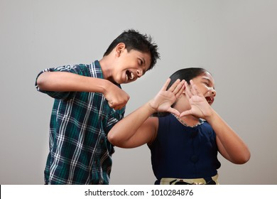 Angry elder brother attcks his sister