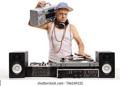 Angry elderly DJ with a boombox playing music on a turntable isolated on white background