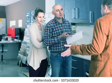 angry european couple makes claims at   kitchen furniture  workshop
