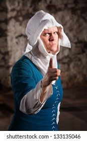 Angry European renaissance nun with pointing finger