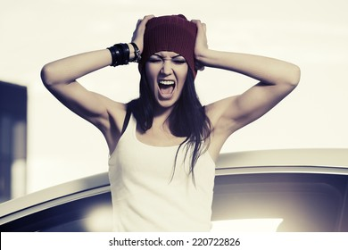 Angry fashion woman shouting at the car