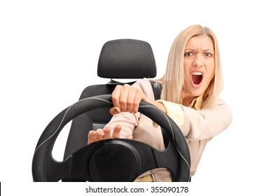Angry female driver yelling and honking on the horn isolated on white background
