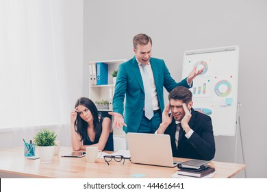 Angry frustrated boss screaming at his workers for bad plan