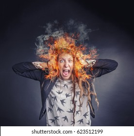 Angry frustrated woman burning with rage, her head is on fire