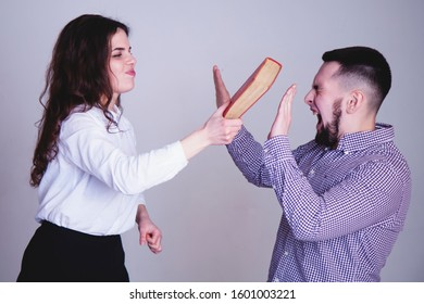 Angry frustrated young people swearing. Woman hitting her boyfriend. Conflict and negative emotion concept