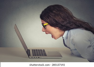 Angry furious businesswoman working on computer, screaming. Negative human emotions, facial expressions, feelings, aggression, anger management issues concept