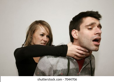 angry girl chocking her boyfriend from behind