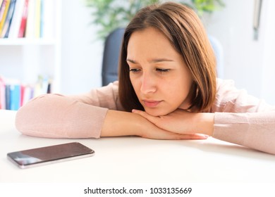 Angry girl waiting for a mobile smartphone call