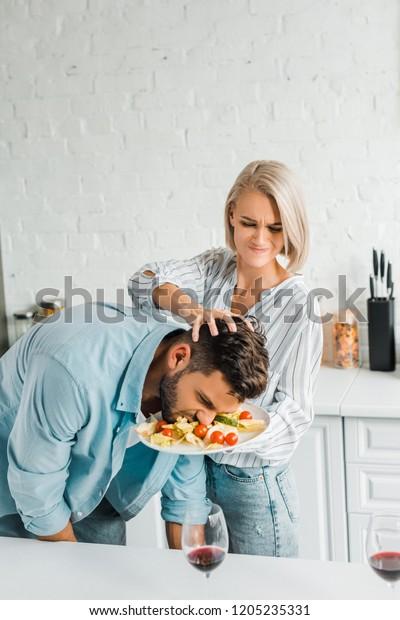 Angry Girlfriend Smashing Boyfriend Face Into Stock Photo