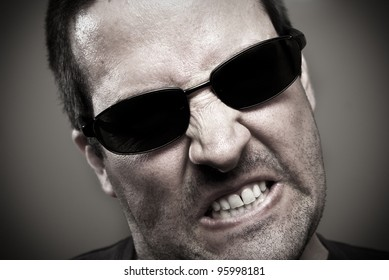 Angry guy in sunglasses