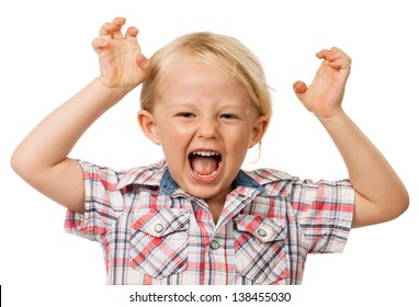 A angry hyperactive young boy screaming. Isolated on white.