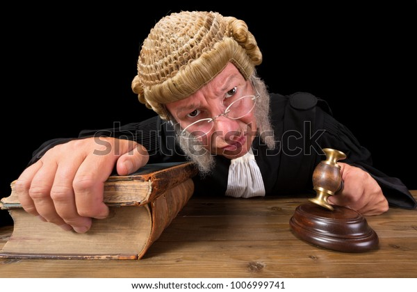 Angry judge in extreme wide angle closeup with hammer and wig