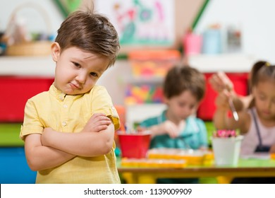 Angry little boy in classroom