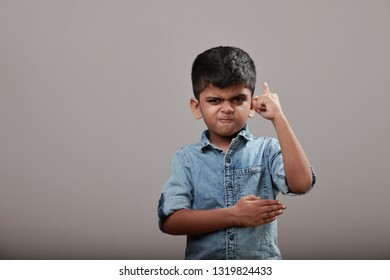 Angry little boy with a fighting gesture