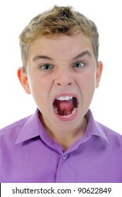 Angry little boy. Isolated on a white background