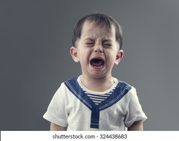 Angry little boys with sad expressions, screaming and crying