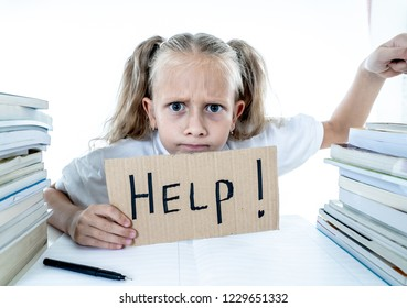 Angry little girl with a negative attitude towards studies and school after studying too much and having too many homework in children education concept isolated on a white background
