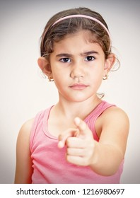Angry little girl pointing with her finger