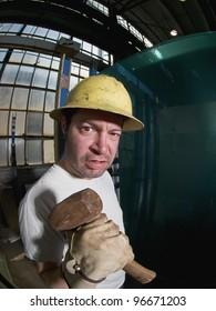 Angry Male Construction Worker with hammer, fisheye