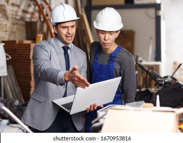 Angry male manager unhappy with quality of work of employee on building
